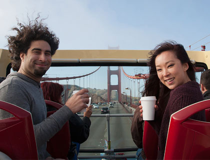 Alcatraz and 48r Hop On Hop Off Combo Ticket- Couple Traveling Over The Golden Gate Bridge