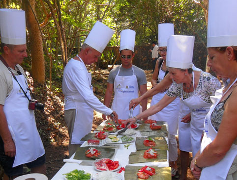 Preparing a traditional Mayan dish on the Be Maya Experience Cancun