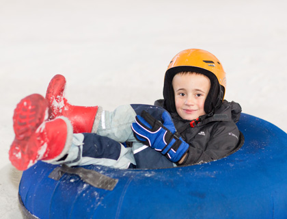 boy Snow Tubing at Chill Factore Manchester