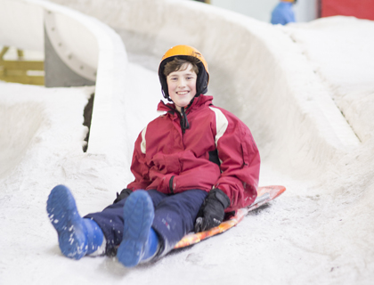 child snowboarding at chill factore in manchester
