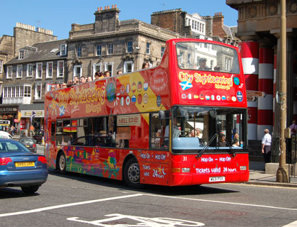 CitySightseeing Edinburgh- Tour Bus Driving Through Edinburgh