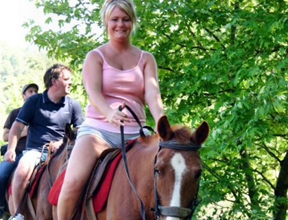 Horse Riding In Side- Woman On Horseback