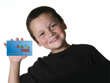 Kids Eat Free Orlando- Boy Holding Kids Eat Free Card