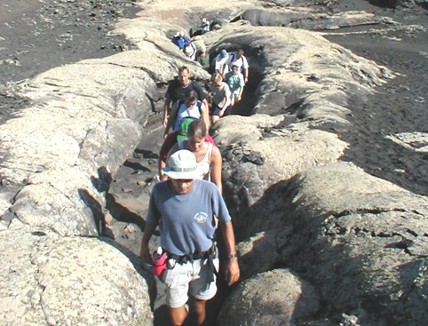 People walking lunar landscape tour lanzarote