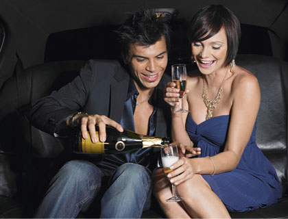Las Vegas Limo Transfers- Couple Pouring Champagne In Limo