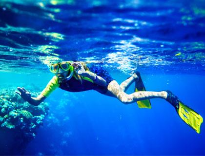 Sharm El Naga Trip From Hurghada- Child Snorkelling Near Coral Reef