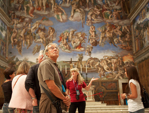 Group looking at artwork in sistine chapel