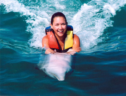 Swim with Dolphins Mayan Riviera and Fantasy Snorkel-  Woman Swimming On Dolphins Belly