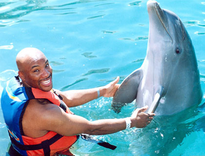 Swim with Dolphins Mayan Riviera and Fantasy Snorkel- Guy and Dolphin Join Hands And Fins