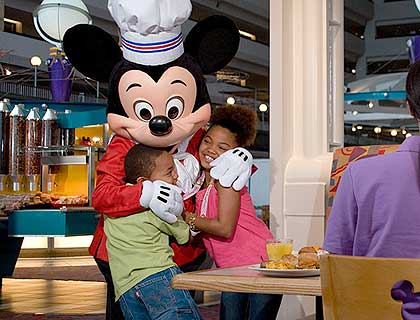 VIP Limousine & Chef Mickey Dinner- Chef Mickey Giving Children A Hug