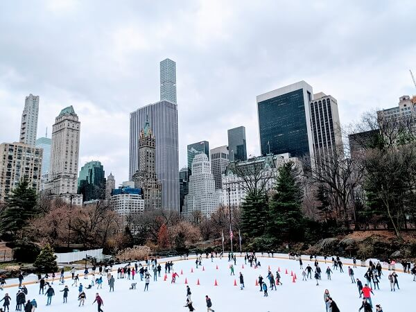 Wollman Ice Skating Rink- People Ice Staking In Central Park