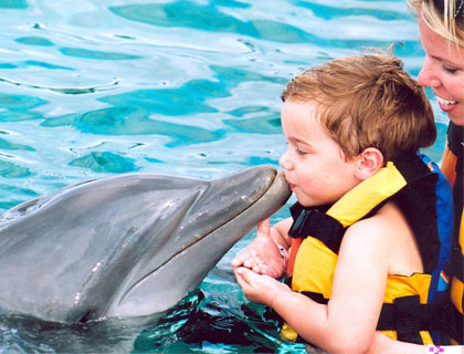 Swim with Dolphins Mayan Riviera and Fantasy Snorkel- Child Giving Dolphin A Kiss