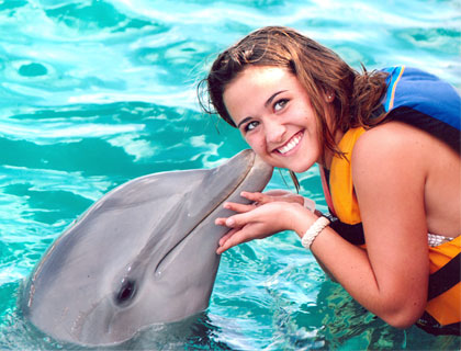 Swim with Dolphins Mayan Riviera and Fantasy Snorkel- Dolphins Kissing Girl On The Cheek