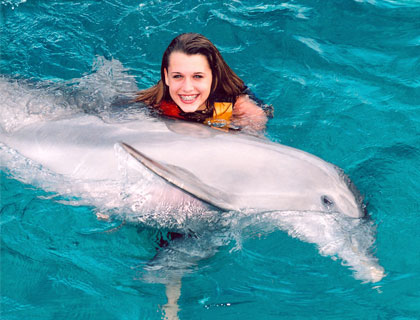 Swim with Dolphins Mayan Riviera and Fantasy Snorkel- Girls Gives Dolphin A Hug